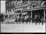 Photograph of the Central Building and Pioneer Day parade, 1898