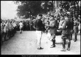 Image of Photograph of Alma Richards receiving medals from John J. Pershing for victories in the American Expeditionary Forces Championships