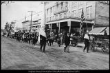 [BYU band passes Taylor's Department Store on Center Street in Provo on Founder's Day, 1914]
