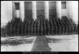 "[Student Army Training Corps standing at ""post arms"" on the steps of the Maeser..."