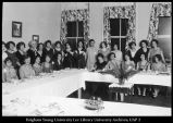 [Home economics students and faculty members at their annual dinner, 1920s]
