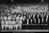 [Dr. H. Franklin Madsen and Dr. Gerrit de Jong, Jr. pose with a large mixed chorus, 1928]