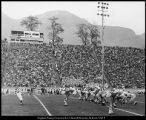 [Football game at the hillside stadium, 1950s]