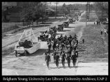 [Parade heads towards campus during the Semi-Centennial celebrations, 1925]
