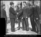 Image of Photograph of Joseph K. Nicholes greeting soldiers on campus