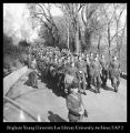 "[Troops march down ""lovers lane"" on the south slope of campus, ca. 1942]"