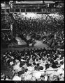 Image of Photograph of Ernest L. Wilkinson speaking at a devotional in the Smith Fieldhouse