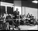 Photograph of Herald R. Clark at the ribbon cutting for the Clark Building
