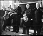 [President McKay hands Mrs. McKay the scissors at the ribbon-cutting ceremony for the opening of...