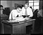 [William H. Snell instructs a drafting student, 1940s]
