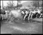[The Brickers and Tausig social units compete in a tug-of-war, May 20, 1953]