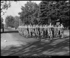 "[The women's Sponsor Corps,""Angel Flight,"" marches in a parade, 1952]"