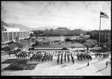 [Air Force and Army ROTC personnel assemble on the Smoot Building quad for the lowering of the...
