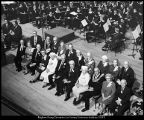 [Guests on stage during the naming ceremonies of various areas in the Harris Fine Arts Center,...