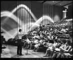 Image of Photograph of Dr. Ralph Woodward conducting a practice session of the A Capella Choir
