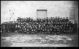 Image of Photograph of the student body of Brigham Young Academy in front of the ZCMI warehouse