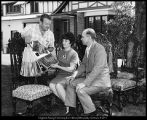 [President and Mrs. Dallin H. Oaks confer with upholsterer John Paulson during the renovation of...