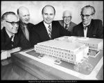 [University administrators examine a model of the addition to the Harold B. Lee Library, March...