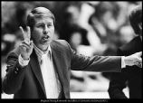 [Coach Glenn Potter flashes signals to his players from the bench, 1972]