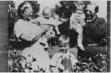Cora and Max Holman and children.