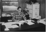Dr. Clarence Hulet at his desk at...
