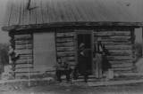 Ernest Spencer in front of cabin