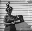 Helen Dunn displaying poppy hat