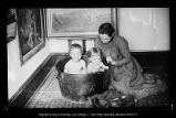 [Two children in a washtub]