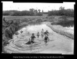 [People bathing in a creek.]
