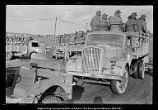 [German prisoners of war in trucks]