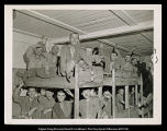[Ebensee concentration camp prisoners in bunk beds]