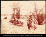 Golde woman gathering firewood.  #1147
