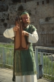 Man Dressed in Priestly Robes Playing Davidic Harp at Temple Mount