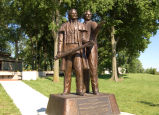 """Eyes Westward,"" statue of Joseph Smith and Brigham Young on the banks of the..."