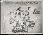 Photographs of campus planning maps and building sketches