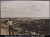 Photograph of man standing above Calf Creek Canyon