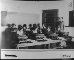 Typing class 1914. L to R, back row: ??, Effie Beesley, ??, Ethelwynne Griggs. Front row: Cora...