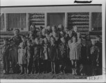 Log School house after Victor School burned about 1941. Leah Jones Teacher. L to R, front row:...