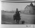 Victor Church. Joe or John Dewey on horseback.