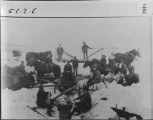 Threshing in Alta, Wyoming. Jacksons, Brown, Edestmons and others in four feet of snow.