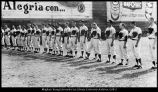 Members of the baseball team stand at attention during the playing of the Mexican and United States national anthems before a game in Mexico City, 1965