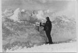 Irene V. Bowhay putting mail in John Laricks mail box. (mail carrier)